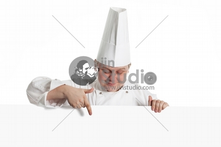 Male Chef Holding A Notice Board Over A White Background