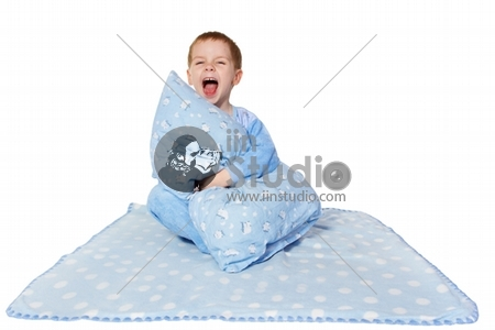 Child shouting loud, sitting on blanket. White background