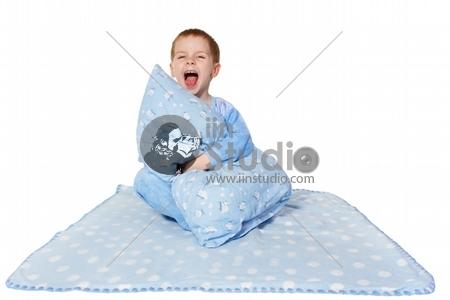 Child shouting loud, sitting on blanket. White background