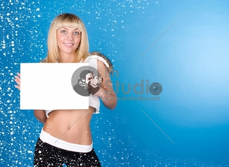 Closeup portrait of cute young woman holding a white page on a blue background