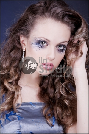beautiful brunette woman with the excellent makeup and the curly hair