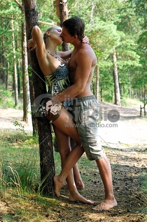 Young beautiful couple are kissing at the beach