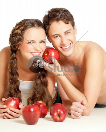 attractive young couple with red apples
