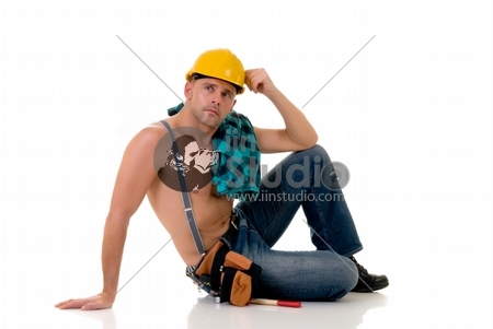 Handsome pre middle aged construction worker in sensual pose