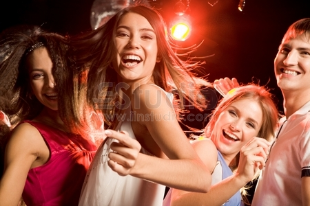 Closeup Of Laughing Young Girls Enjoying At Nightclub