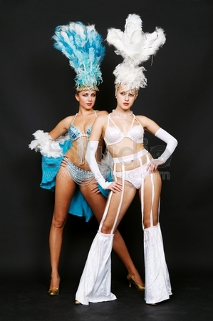 Two Attractive Cabaret Dancers Over Dark Background