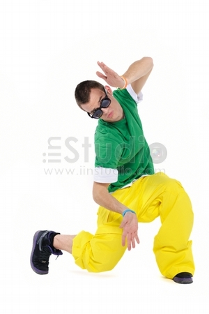 Male breakdancer posing, isolated on a white background