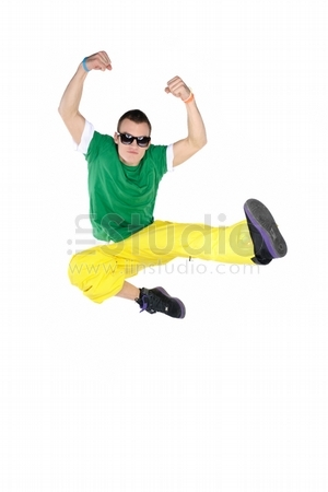 Male breakdancer jumping, isolated on white