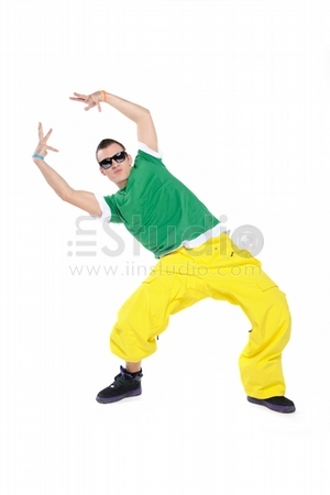 Breakdancer dancing, isolated on a white background