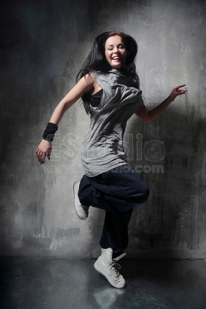 the dancer posing on dark grey background