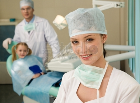 Beautiful woman wearing uniform looking at camera with smile on background of workplace