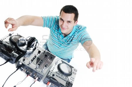 young dj man with headphones and compact disc dj equipment
