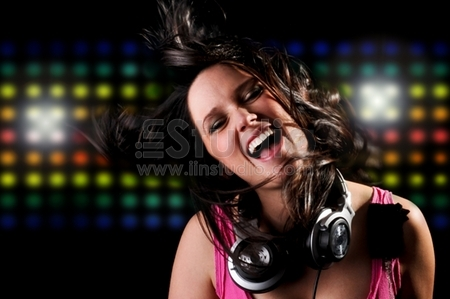 Beautiful DJ Girl Singing and Dancing with Club Lights in the background