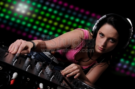 Beautiful DJ Girl Performing with Club Lights in the background