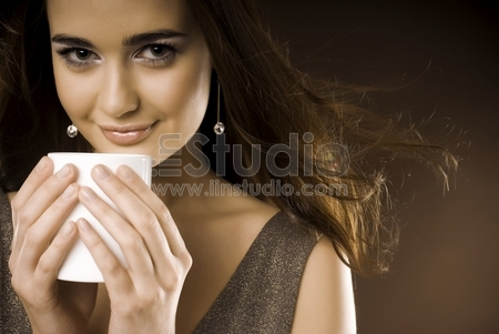 Beautiful young woman with a cup of a cafe