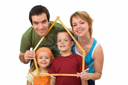 Happy family with their kids planning to buy a new home - isolated