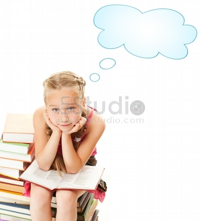 Little schoolgirl sitting on a stack of books