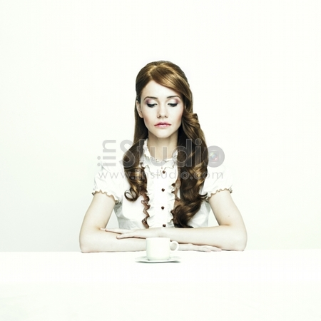 Portrait of a beautiful elegant lady at white table