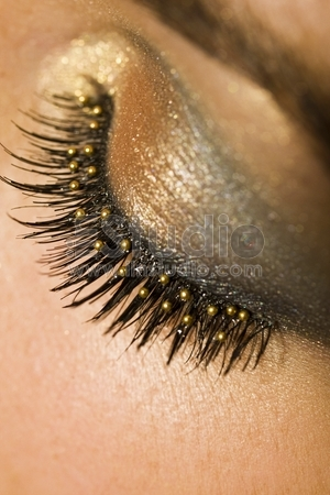 A macro close up of a beautiful woman's made up eye with false eyelashes