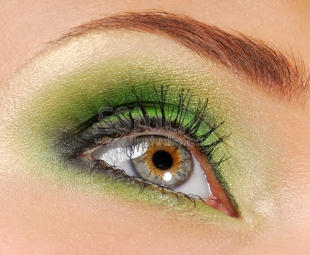 Woman eyes with bright green color of eyeshadow cosmetic