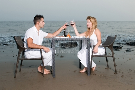 Loving couple at a romantic dinner in the beach