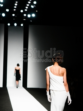 Models on the catwalk during a fashion show.