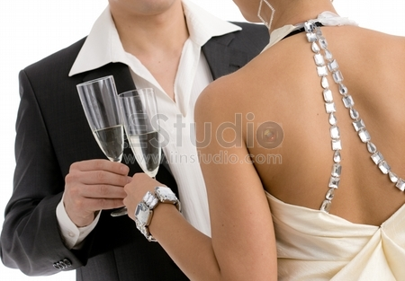 Hands holding champagne flutes, clinking. Isolated on white backround.