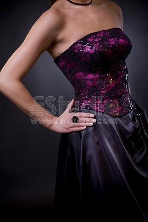 Photo of a purple, laced coktail dress with black skirt