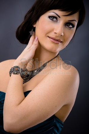 Closeup portrait of beautiful young woman wearing dark blue evening dress