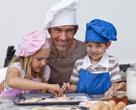 Father and daughter and son baking cookies in the kitchen