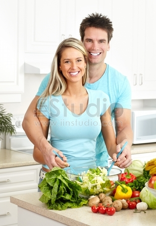 Young love couple cooking at kitchen