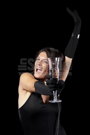 beautiful woman celebrating the new year eve with champagne (isolated on black)