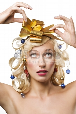 funny portrait of a young woman with christmas decoration in hair