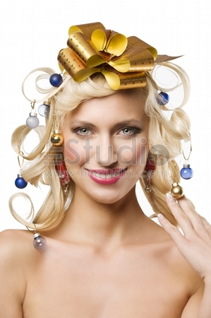 nice porrait of a beautiful woman with hair style with christmas decoration