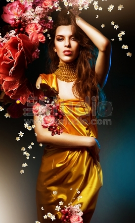 sensual sexy woman in green dress with flowers and blue light