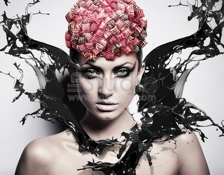 Sexy Woman With Black Splash And Candies On Head