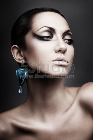 Portrait of brunette woman with diamond earring