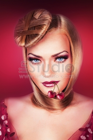 blond woman with blue eyes and cherry