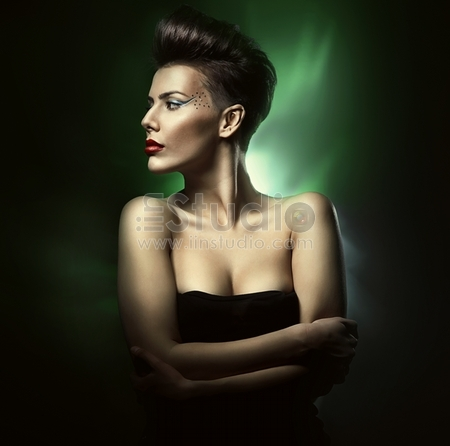 beautiful sexy woman with red lips in green light