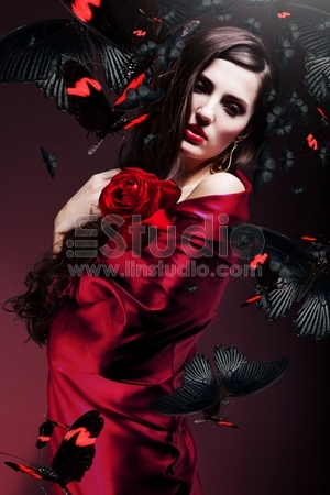Beautiful woman in red fabric with red roses beautiful woman in red fabric