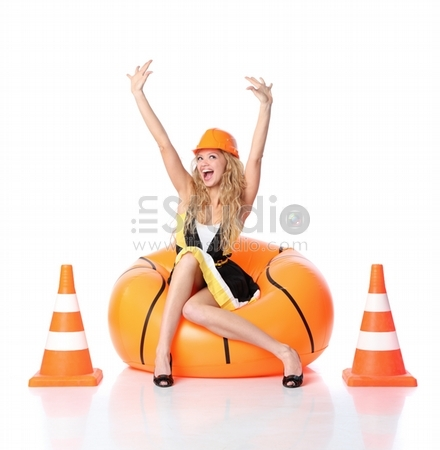 Sexy blond female construction worker being happy