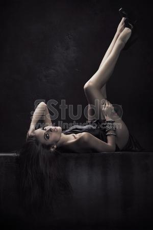 Brunette beauty in a dark chamber
