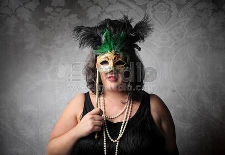 Fat girl wearing a venetian mask