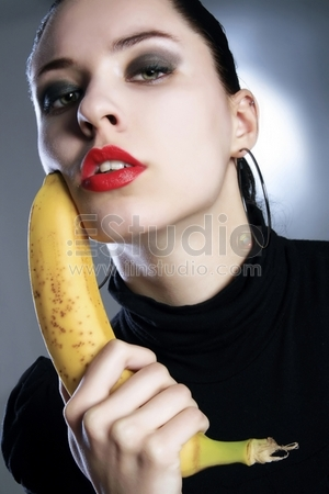 attractive black lady with banana gun in hands