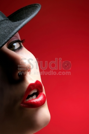 a half of a beauty female face with red lips