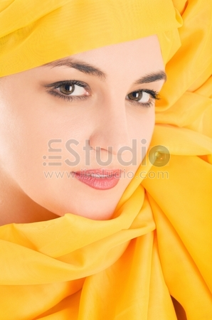 Woman covering with yellow chiffon cloth