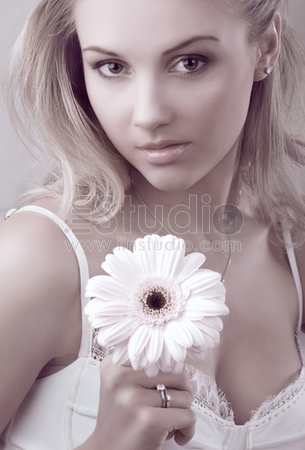 young beautiful woman holding flower isolated on white