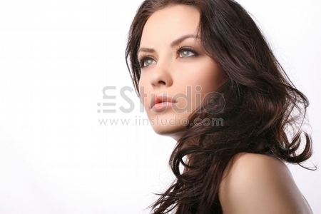 attractive young woman isolated on white looking away from camera