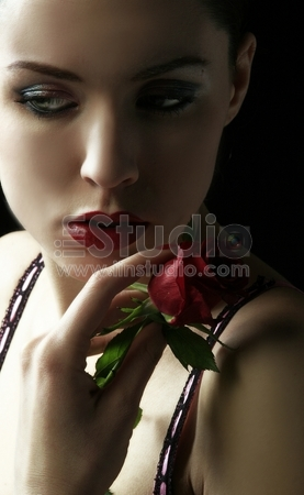 sensual woman with red rose in trance