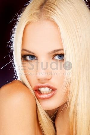 Closeup, Studio Shot Of A Beautiful Blond Girl